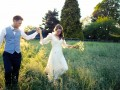 Bride and groom in the fields thumbnail